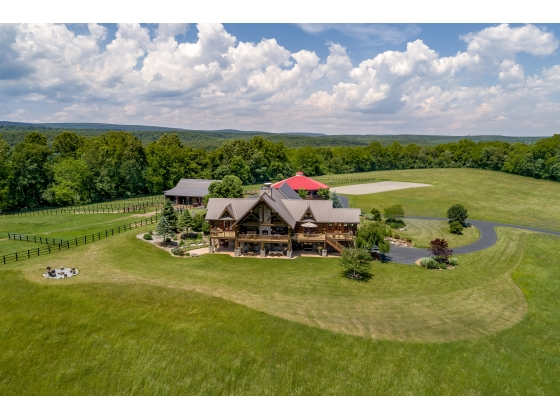 25 Acres w/ Custom Handcrafted Log Cabin Home & State of the Art Equestrian Facilities. Taxes = $14,000/yr