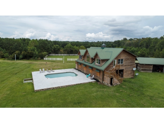 Home with pool situated above 7 stall barn