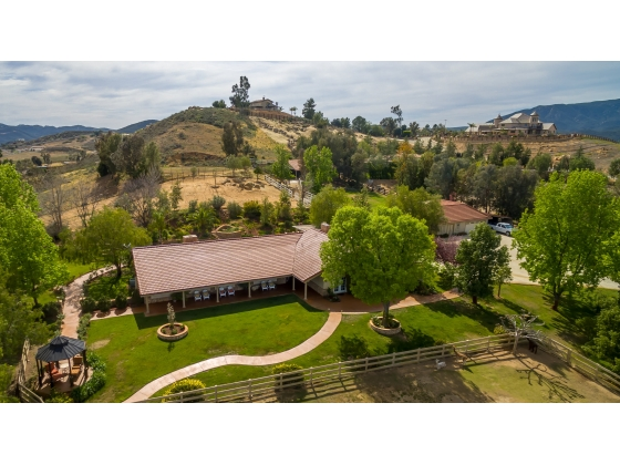$90k PRICE DROP!!! PRICED TO SELL AT $1.145M!! ONE LEVEL RANCH HORSE PROPERTY + GUEST HOUSE + 2 BARNS ON 5.02 ACRES