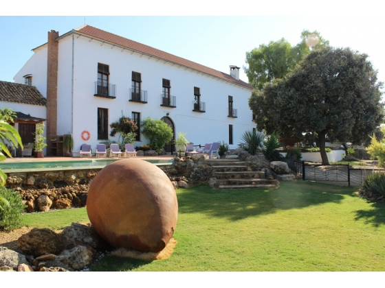Beautifully restored Spainish Cortijo holiday and riding centre deep in the rolling hills of Malaga and Business