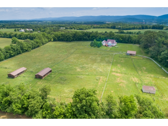 11+ ACRE FULLY FENCED FARM W/ SEVERAL BARNS & A BEAUTIFUL CUSTOM HOME!