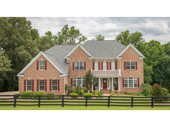 Custom colonial on 10 acres with 4 stall barn and 4 fenced paddocks