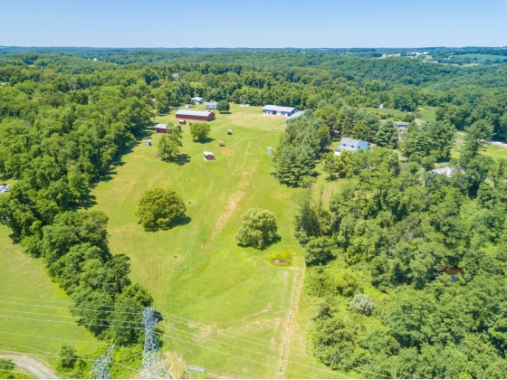Nearly 10 ac. Land with 8 ac. Fenced Pasture * Custom Built Tri-Level Home with 2-Car Att. Garage * 10-Stall Center Aisle Barn