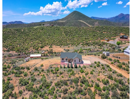 Custom home on over 5 acres with beautiful views of Arizona's western skies!