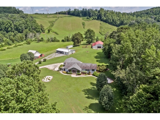 23 acre- Unrestricted-Horse/Mini Farm with lush green pastures-2 barns and storage shed & workshop
