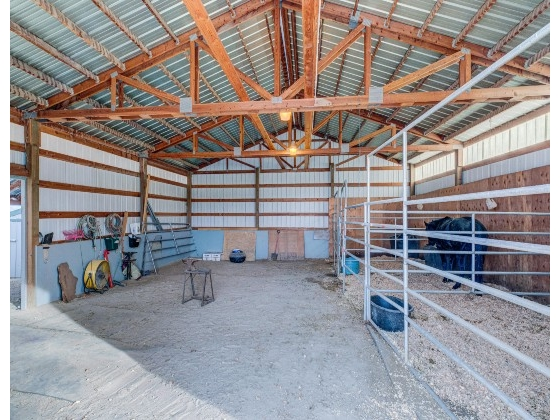 Only 5 minutes from downtown Emmett sits almost 4 acres near the quiet south slope bluff. A wonderful horse property with a roping arena, a 36 x 36 barn with stalls, tack room, horse safe pens with shelters, and an easy to irrigate pasture. Move-in ready