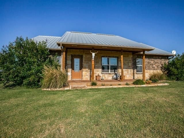 Charming stone and brick home with hill top views on 13 acres in Tioga, Texas