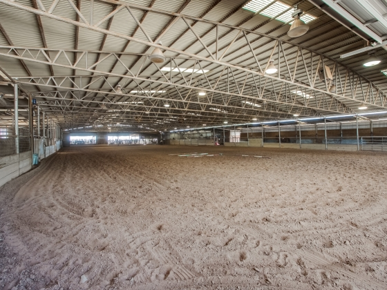 The indoor arena is 90 ft x 200 ft with a large, screened holding area for cattle on the south end