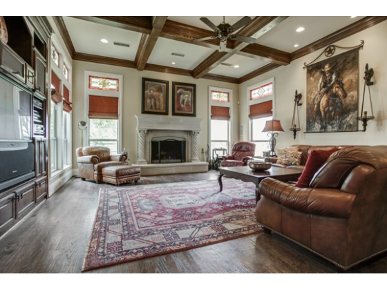 Family room with fireplace (1 of 3), surround sound and Pella windows