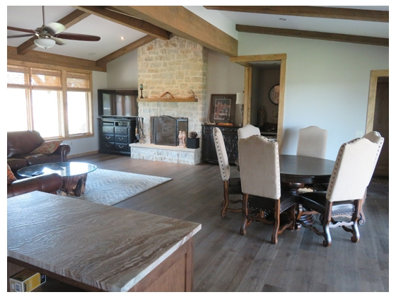 Family room with stone gas log fireplace and bar...wine cooler and beverage refrigerator