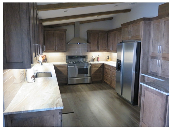 Double convection ovens and maple cabinetry. Separate utility and mud room
